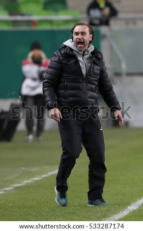 BUDAPEST, HUNGARY - DECEMBER 10, 2016: Head coach Thomas Doll of Ferencvarosi TC disagrees about the decision of the referee during Ferencvaros v MTK OTP Bank Liga match at Groupama Arena