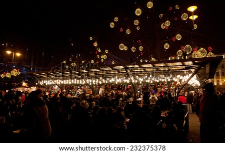 BUDAPEST, HUNGARY - DECEMBER 31, 2012: People enjoy New Year's market at Vorosmarty square in center of Budapest city - stock photo