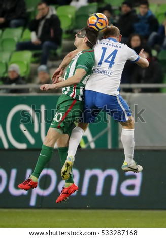 BUDAPEST, HUNGARY - DECEMBER 10, 2016: Zoltan Gera (L) of Ferencvaros battles for the ball in the air with Sandor Torghelle #14 of MTK during Ferencvaros v MTK OTP Bank Liga match at Groupama Arena