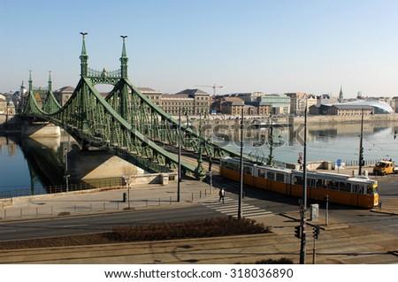 BUDAPEST, HUNGARY - FEBRUARY 21, 2012: A tram crosses the Liberty Bridge in Budapest, Hungary, on February 21, 2012. - stock photo