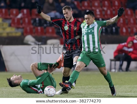 BUDAPEST, HUNGARY - FEBRUARY 27, 2016: Duel between Eppel of Honved (m) and Ramirez (r) of Ferencvaros next to Pinter during Honved - Ferencvaros OTP Bank League football match at Bozsik Stadium. - stock photo