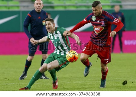 BUDAPEST, HUNGARY - FEBRUARY 10, 2016: Duel between Zoltan Gera of Ferencvaros (l) and Robert Feczesin of Videoton during Ferencvaros - Videoton Hungarian Cup football match at Groupama Arena. - stock photo
