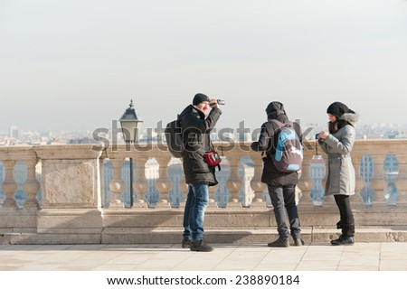 BUDAPEST, HUNGARY - FEBRUARY 15, 2014: Tourists take photos of the city