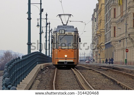 BUDAPEST, HUNGARY - FEBRUARY 19, 2012: Yellow tram number 2 on the route in Pest part of Budapest early in the morning