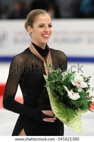 BUDAPEST, HUNGARY - JANUARY 17, 2014: Carolina KOSTNER of Italy poses at the victory ceremony at ISU European Figure Skating Championship in Syma Hall Arena. - stock photo
