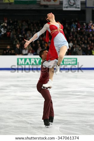 BUDAPEST, HUNGARY - JANUARY 16, 2014: Charlene GUIGNARD / Marco FABBRI of Italy perform free dance at ISU European Figure Skating Championship in Syma Hall Arena. - stock photo