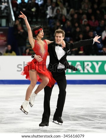 BUDAPEST, HUNGARY - JANUARY 15, 2014: Elena ILINYKH / Nikita KATSALAPOV of Russia perform short dance at ISU European Figure Skating Championship in Syma Hall Arena.