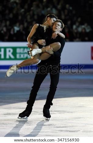 BUDAPEST, HUNGARY - JANUARY 19, 2014: Elena ILINYKH / Nikita KATSALAPOV perform during the exhibition gala at ISU European Figure Skating Championship in Syma Hall Arena. - stock photo