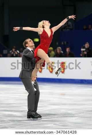 BUDAPEST, HUNGARY - JANUARY 16, 2014: Isabella TOBIAS / Deividas STAGNIUNAS perform free dance at ISU European Figure Skating Championship in Syma Hall Arena. - stock photo
