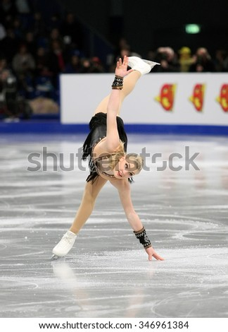 BUDAPEST, HUNGARY - JANUARY 17, 2014: Joshi HELGESSON of Sweden performs free program at ISU European Figure Skating Championship in Syma Hall Arena. - stock photo