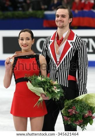 BUDAPEST, HUNGARY - JANUARY 19, 2014: Ksenia STOLBOVA / Fedor KLIMOV of Russia pose at the victory ceremony at ISU European Figure Skating Championship in Syma Hall Arena. - stock photo