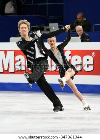 BUDAPEST, HUNGARY - JANUARY 16, 2014: Penny COOMES / Nicholas BUCKLAND of Great Britain perform free dance at ISU European Figure Skating Championship in Syma Hall Arena. - stock photo