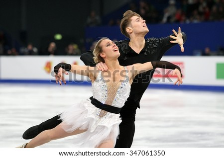 BUDAPEST, HUNGARY - JANUARY 16, 2014: Pernelle CARRON / Lloyd JONES of France perform free dance at ISU European Figure Skating Championship in Syma Hall Arena. - stock photo