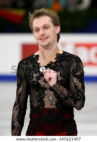 BUDAPEST, HUNGARY - JANUARY 18, 2014: Sergei VORONOV of Russia poses at the victory ceremony at ISU European Figure Skating Championship in Syma Hall Arena.