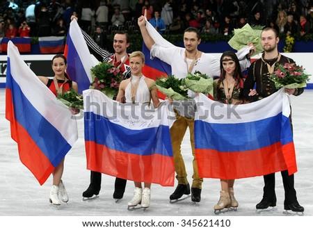 BUDAPEST, HUNGARY - JANUARY 19, 2014: STOLBOVA/KLIMOV, VOLOSOZHAR/TRANKOV, BAZAROVA/LARIONOV pose at the victory ceremony at ISU European Figure Skating Championship in Syma Hall Arena. - stock photo
