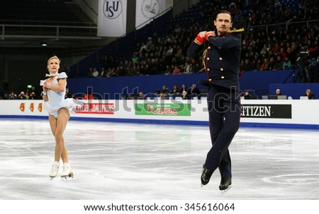 BUDAPEST, HUNGARY - JANUARY 17, 2014: Tatiana VOLOSOZHAR / Maxim TRANKOV of Russia perform short program at ISU European Figure Skating Championship in Syma Hall Arena. - stock photo