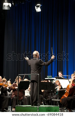 BUDAPEST, HUNGARY - JANUARY 15: The MAV  Symphonic Orchestra performs at The Millenaris stage on January 15, 2011 in Budapest, Hungary. Conductor: Laszlo Kovacs