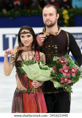 BUDAPEST, HUNGARY - JANUARY 19, 2014: Vera BAZAROVA / Yuri LARIONOV of Russia pose at the victory ceremony at ISU European Figure Skating Championship in Syma Hall Arena. - stock photo