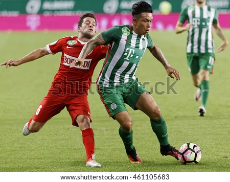 BUDAPEST, HUNGARY - JULY 30, 2016: Cristian Ramirez #77 of FTC duels for the ball with Diego Vela #6 of DVTK during the Hungarian OTP Bank Liga match between Ferencvarosi TC and DVTK at Groupama Arena