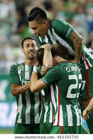 BUDAPEST, HUNGARY - JULY 30, 2016: Cristian Ramirez (R) of FTC and Leandro De Almeida (L) celebrate the first goal during the OTP Bank Liga match between Ferencvarosi TC and DVTK at Groupama Arena.