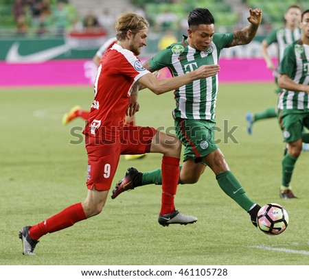 BUDAPEST, HUNGARY - JULY 30, 2016: Cristian Ramirez (R) of FTC duels for the ball with Patrik Bacsa #9 of DVTK during the OTP Bank Liga match between Ferencvarosi TC and DVTK at Groupama Arena.