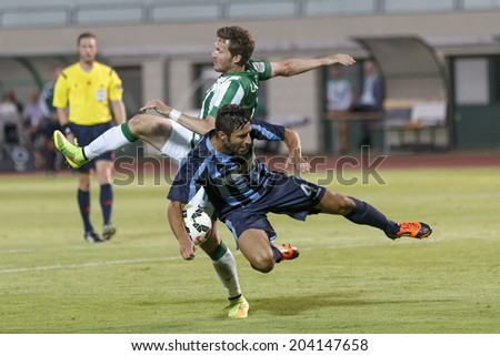 BUDAPEST, HUNGARY - JULY 10, 2014: Duel between Benjamin Lauth of FTC (l) and Filippo Scozzese of Sliema during Ferencvarosi TC vs. Sliema UEFA EL football match at Puskas Stadium.