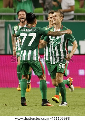 BUDAPEST, HUNGARY - JULY 30, 2016: Emir Dilaver #66 of FTC celebrates his goal with Cristian Ramirez #77 during the Hungarian OTP Bank Liga match between Ferencvarosi TC and DVTK at Groupama Arena.