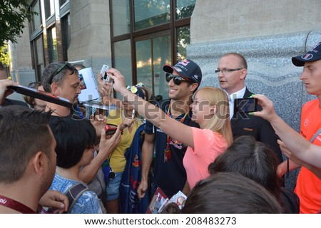 BUDAPEST, HUNGARY-  JULY 26: F1 driver Daniel Ricciardo is among his fans and giving autographs on July 26, 2014 in Budapest.