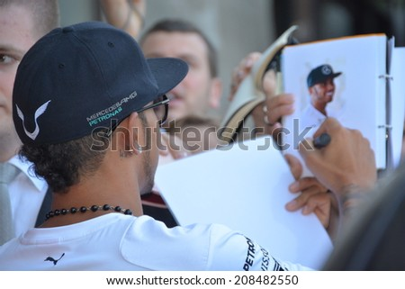 BUDAPEST, HUNGARY-  JULY 27: F1 driver Lewis Hamilton is among his fans and giving autographs on July 27, 2014 in Budapest.