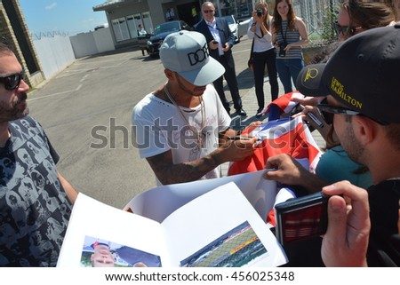 BUDAPEST, HUNGARY-  JULY 21: F1 driver Lewis Hamilton is among his fans and giving autographs on July 21, 2016 in Budapest. - stock photo