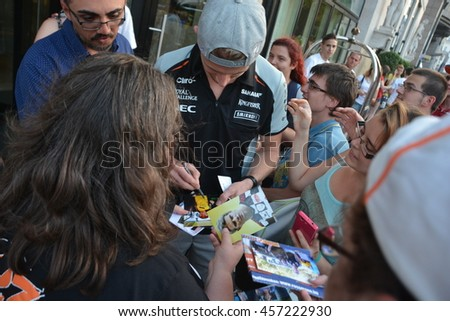 BUDAPEST, HUNGARY-  JULY 23: F1 driver Nico Hulkenberg is among his fans and giving autographs on July 23, 2016 in Budapest. - stock photo