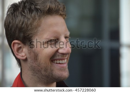 BUDAPEST, HUNGARY-  JULY 24: F1 driver Romain Grosjean is among his fans and giving autographs on July 24, 2016 in Budapest. - stock photo