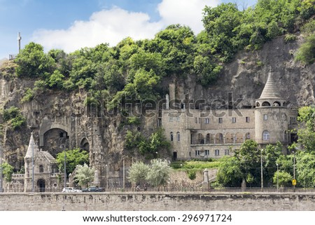 BUDAPEST, HUNGARY, JULY 10,2015: Front view of Gellert Hill Cave Church,located near the Buda end of Liberty Bridge, across from the famous Gellert Baths. - stock photo