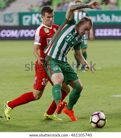 BUDAPEST, HUNGARY - JULY 30, 2016: Gergo Lovrencsics (R) of FTC fights for the ball with Milan Nemes #33 of DVTK during the OTP Bank Liga match between Ferencvarosi TC and DVTK at Groupama Arena.