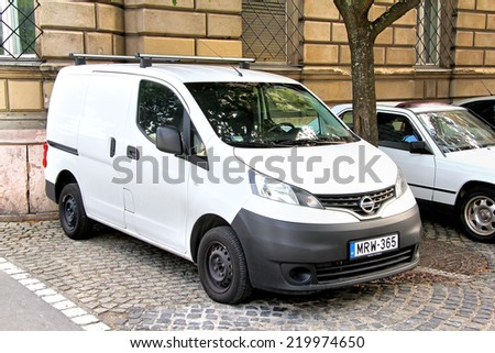 BUDAPEST, HUNGARY - JULY 23, 2014: Japanese cargo van Nissan NV200 at the city street. - stock photo