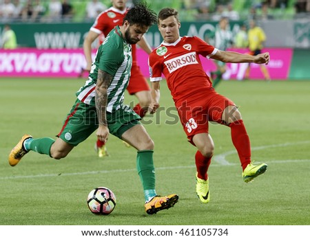 BUDAPEST, HUNGARY - JULY 30, 2016: Marco Djuricin (L) of Ferencvarosi TC shots on goal next to Milan Nemes #33 of DVTK during the OTP Bank Liga match between Ferencvarosi TC and DVTK at Groupama Arena