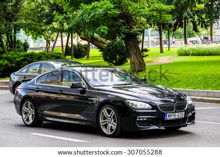 BUDAPEST, HUNGARY - JULY 23, 2014: Motor car BMW F06 6-series Gran Coupe at the city street. - stock photo