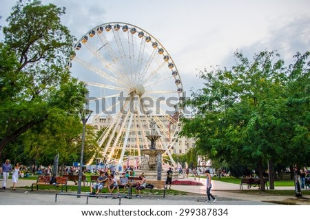 BUDAPEST, HUNGARY, JULY 30, 2014: Night view over ferris wheel situated in center of budapest.