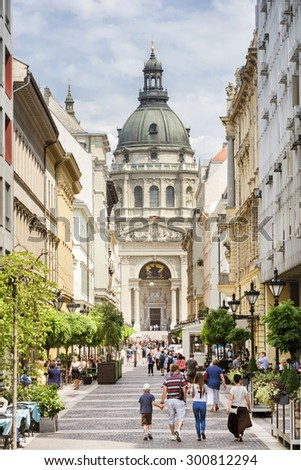 BUDAPEST, HUNGARY, JULY 9,2015: People walking at Zrinyi Street, one of the famous streets in Budapest, St. Stephen's Basilica can be seen at the background. - stock photo