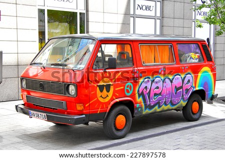 BUDAPEST, HUNGARY - JULY 25, 2014: Red classic van Volkswagen Transporter at the city street. - stock photo