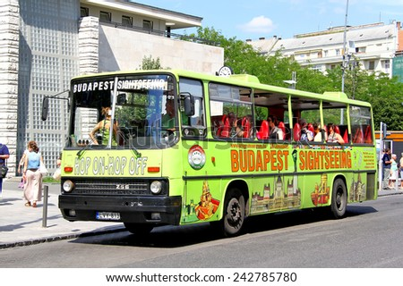 BUDAPEST, HUNGARY - JULY 25, 2014: Vintage city sightseeing bus Ikarus 256 at the city street.