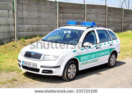 BUDAPEST, HUNGARY - JULY 25, 2014: White police car Skoda Fabia at the countryside. - stock photo