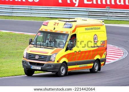 BUDAPEST, HUNGARY - JULY 26, 2014: Yellow ambulance car Volkswagen Crafter at the Hungaroring Formula One Race Track.