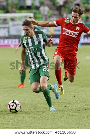 BUDAPEST, HUNGARY - JULY 30, 2016: Zoltan Gera #20 of Ferencvarosi TC duels for the ball with Balint Olah #8 of DVTK during the OTP Bank Liga match between Ferencvarosi TC and DVTK at Groupama Arena.