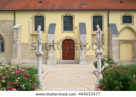 BUDAPEST, HUNGARY - JUNE 10, 2016: Saint Kinga of Poland and Saint Hedwig of Silesia, two stone statues created by David Toth in 2009, at side entrance to Inner City Parish Church of Budapest.