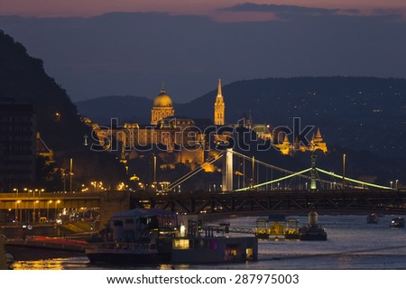 BUDAPEST, HUNGARY - 15 JUNE, 2015: Sunset above the Danube river. Budapest known as city of the bridges.
