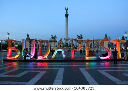 "BUDAPEST, HUNGARY - MARCH 27: Colorfully lit, temporary wooden installation of letters/sign forming ""Budapest"" on Heroes' Square, on March 27, 2014 in Budapest, Hungary. Ideal photo spot for tourists."