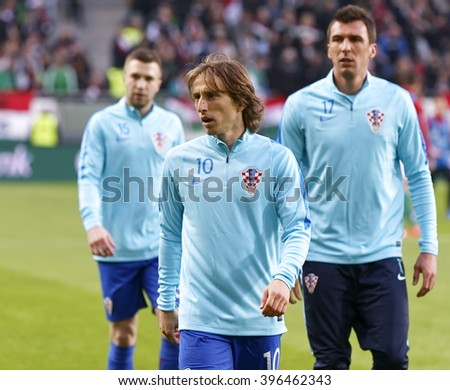 BUDAPEST, HUNGARY - MARCH 26, 2016: Croatian Luka Modric (m) and Mario Mandzukic (r) before Hungary vs. Croatia international friendly football match in Groupama Arena.