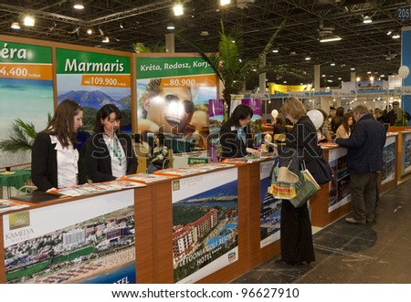 BUDAPEST, HUNGARY - MARCH 3: Unidentified people visit the 35th Travel (2012) � International Tourist Exposition, largest fair its kind in Central Europe  on March 3, 2012 in Budapest, Hungary.