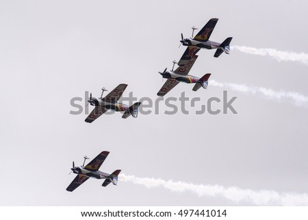 Budapest, Hungary - May 1, 2016. A group of Corvus Racer 540 Red Bull Air Race aircrafts flies inverted in close formation over the river Danube, during an air show at the city of Budapest.
